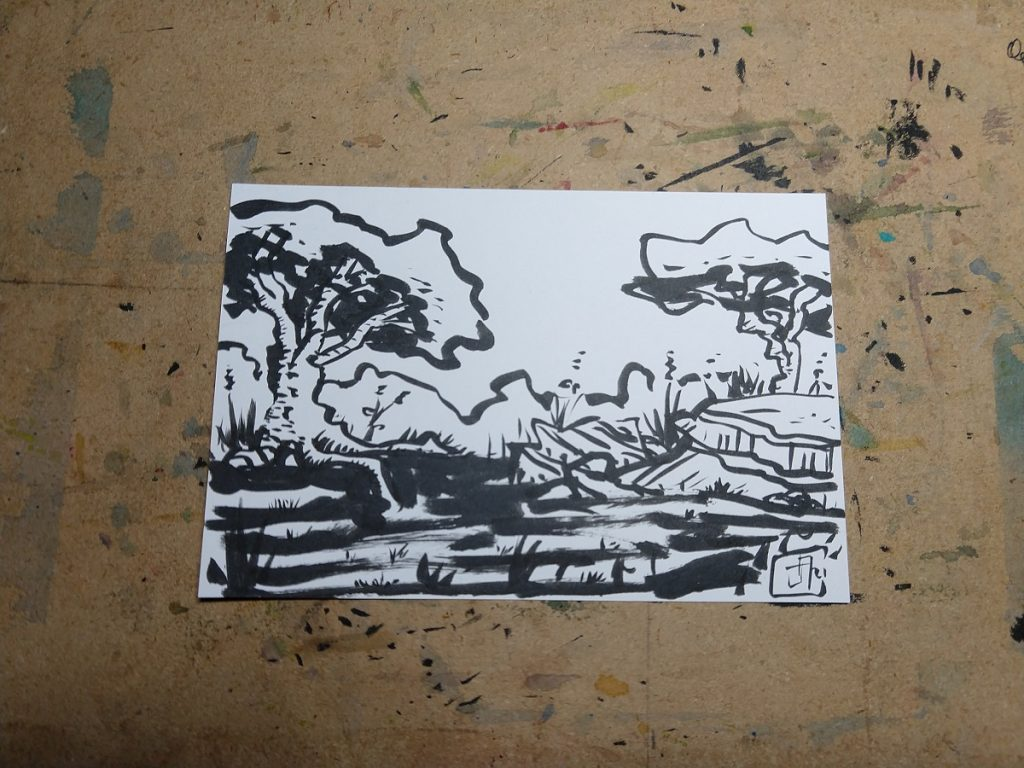 A quick postcard-sized brush pen sketch of trees and rocks in a field