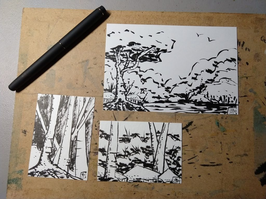 Three brush pen drawings, one post-card sized and the other two trading card sized. All depict trees with a face with either stoic or aloof expressions, with clouds and rocks visible.